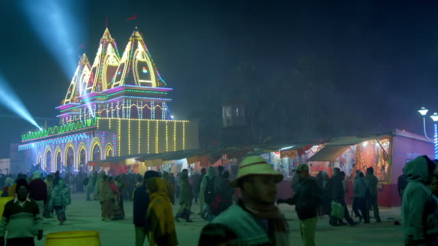 Sequence showing the busy Gangasagar Mela in West Bengal at night, India.