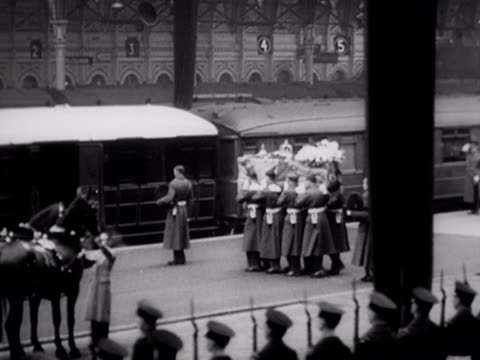 sequence showing the coffin of king george vi arriving at paddington station for his journey to his final resting place at windsor castle. 1952. - paddington railway station stock videos & royalty-free footage