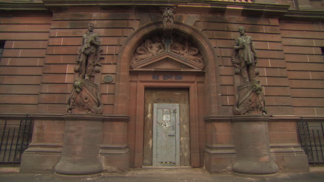 sequence showing the entrance to what is now the fairfield heritage centre filmed in 2014 before restoration, govan, glasgow, scotland. - 2014 stock videos & royalty-free footage