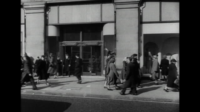 sequence showing the exterior of selfridges department store on london's oxford street - 1949 stock videos and b-roll footage