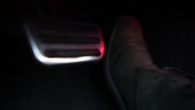sequence showing the footwell of a car as a man wearing desert boots puts his foot on the accelerator pedal, usa. - pedal stock videos & royalty-free footage