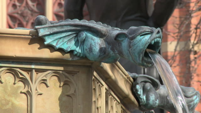 sequence showing the gargoyles of the jubilee fountain in albert square in manchester, uk. - 19th century style stock videos & royalty-free footage