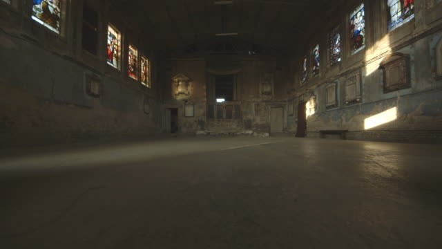Sequence showing the interior of a derelict, dilapidated church in England, UK.