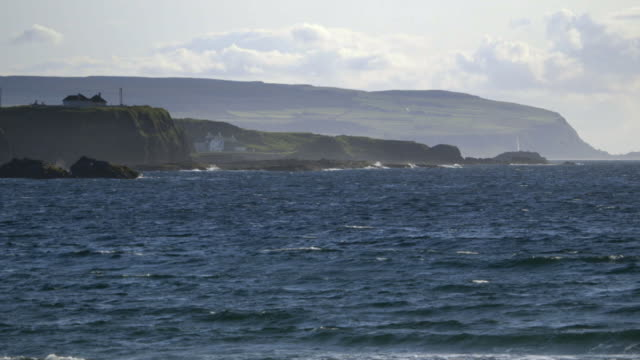 sequence showing the island of rathlin from the choppy irish sea, northern ireland. - rough stock videos & royalty-free footage
