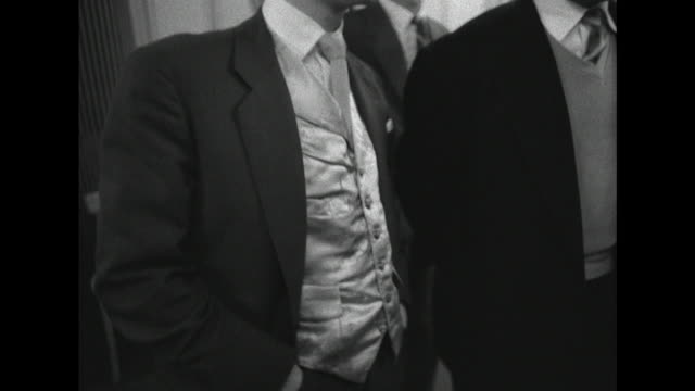 sequence showing the italian style suits worn by young men at a dance at the hammersmith palais - klassischer rock and roll stock-videos und b-roll-filmmaterial