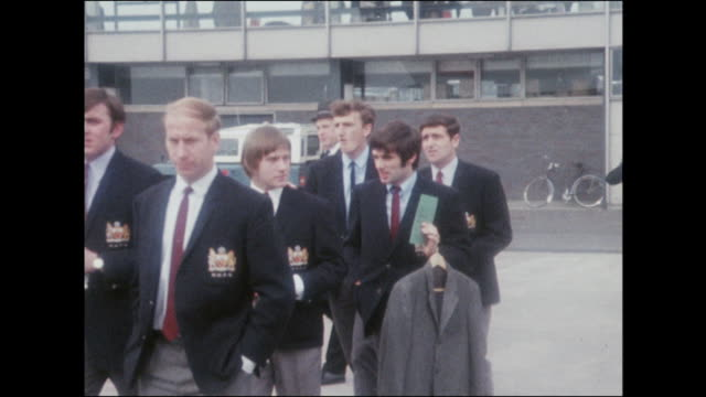 Sequence showing the Manchester United football team boarding a plane to take part in the European Cup