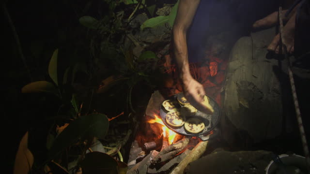 sequence showing the preparation of traditional venezuelan arepas on a campfire and the use of an outdoor gas burner, venezuela. - south america stock videos & royalty-free footage