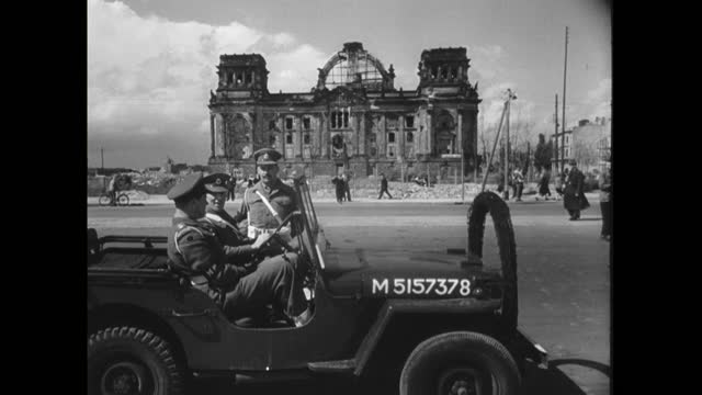 sequence showing the presence of the allied forces on the streets in berlin in 1950. pan french army vehicles drive up a city street. soldiers in a... - capital cities stock videos & royalty-free footage