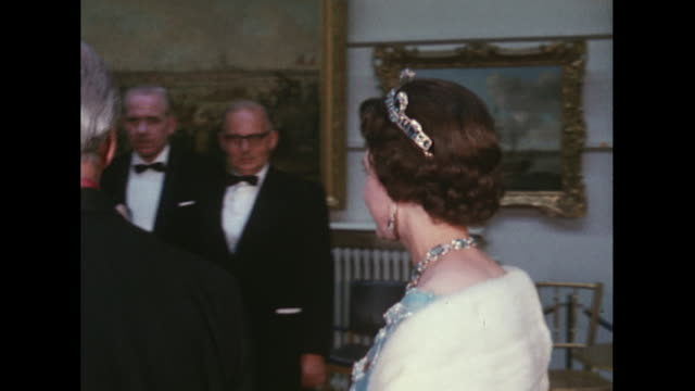 Sequence showing the Queen attending a centenary banquet for the TUC at London's Guildhall