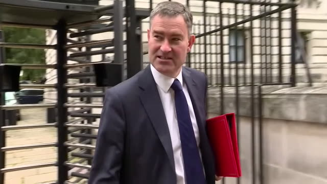 sequence showing the reactions of cabinet members david gauke and alun cairns when asked for their thoughts on theresa may's speech on brexit taking... - seguire attività che richiede movimento video stock e b–roll