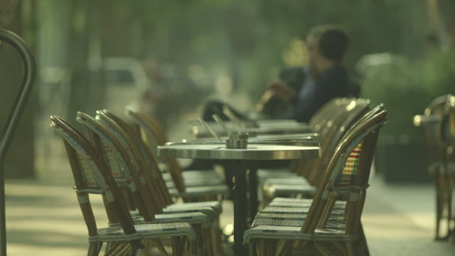 Sequence showing the seemingly delightful outdoor cafe culture of Paris in the early evening light, France.