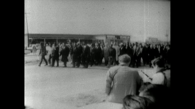 sequence showing the selma peace marchers stopping in front of state troopers on the famous 'turnaround tuesday'. marchers walking along highway, pan... - black civil rights stock videos & royalty-free footage