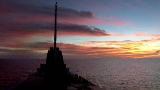 sequence showing the sun setting from a baja ferry crossing the gulf of california. - sea of cortez stock videos & royalty-free footage