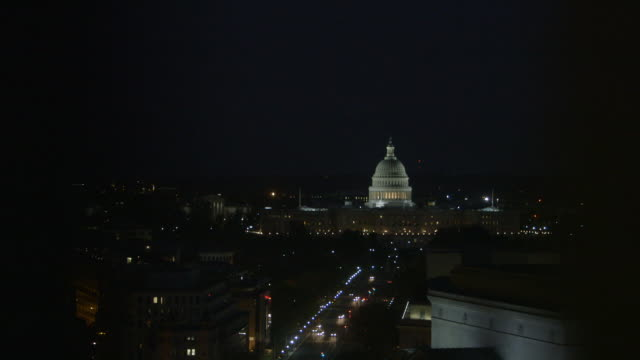 Sequence showing the United States Capitol building at night, USA.