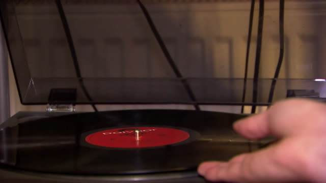 sequence showing the use of a record player in a modern home following a resurgence in the medium manchester uk nnca818p absa627d - record player stock videos & royalty-free footage