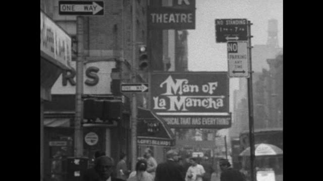 sequence showing theatre hoardings on broadway, advertising various theatrical performances and shows. - broadway manhattan stock-videos und b-roll-filmmaterial