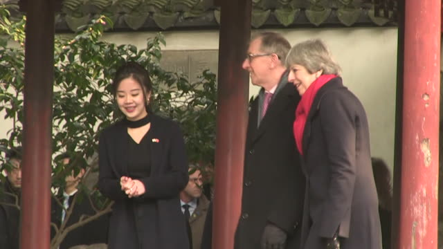 Sequence showing Theresa and Philip May being shown a Koi Carp pond in Beijing