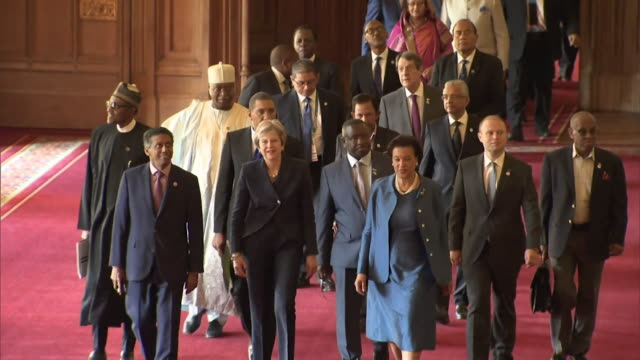 Sequence showing Theresa May leading Commonwealth leaders down 'St George's Hall' in Windsor Castle UK