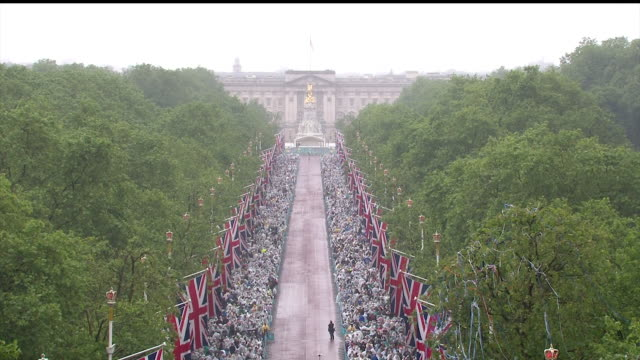 Sequence showing thousands of people attending the 'Patron's lunch' on the Mall to celebrate the Queen's 90th birthday