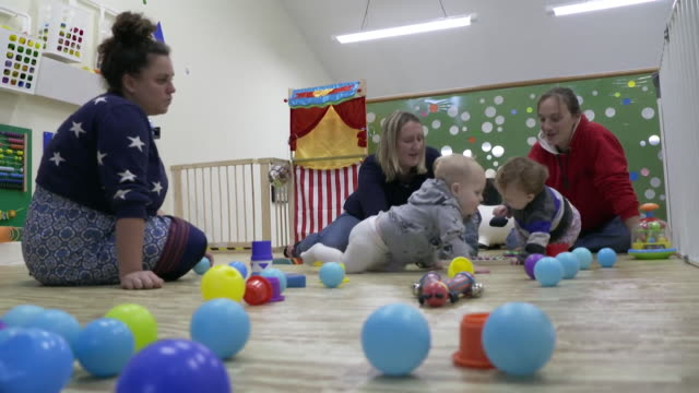 sequence showing toddlers and their mothers playing at a nursery in glasgow - playing stock videos & royalty-free footage
