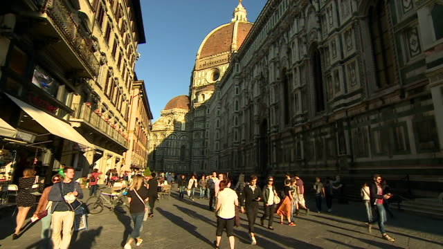 Sequence showing tourists and locals walking around various sites including the Duomo in Florence Italy September 2017 NNBZ124W ABSA627D