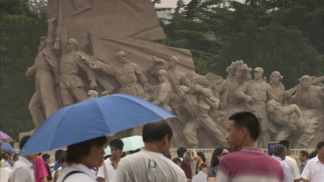 sequence showing tourists visiting the people's statue in tiananmen square, beijing, china. - stone material stock videos & royalty-free footage