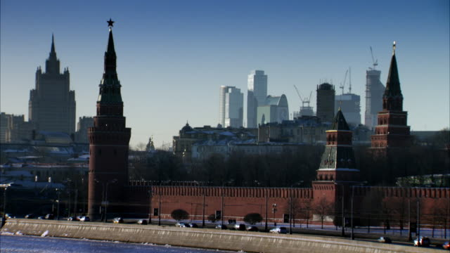 sequence showing traffic driving past the kremlin and the moskva river in moscow. - moscow russia stock videos and b-roll footage
