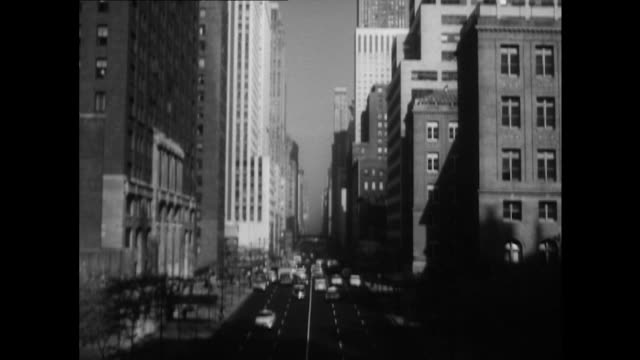 sequence showing traffic moving along streets of new york. - new york city 1950s stock videos & royalty-free footage