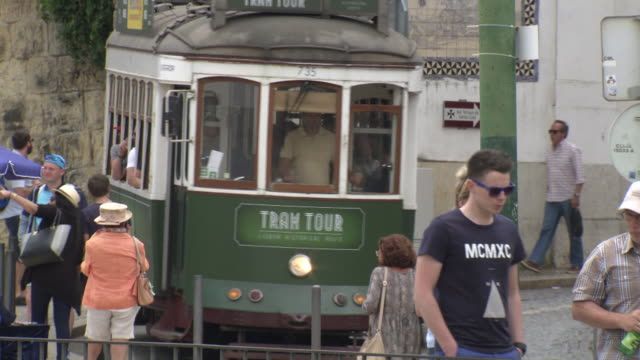 Sequence showing trams in Lisbon, Portugal.