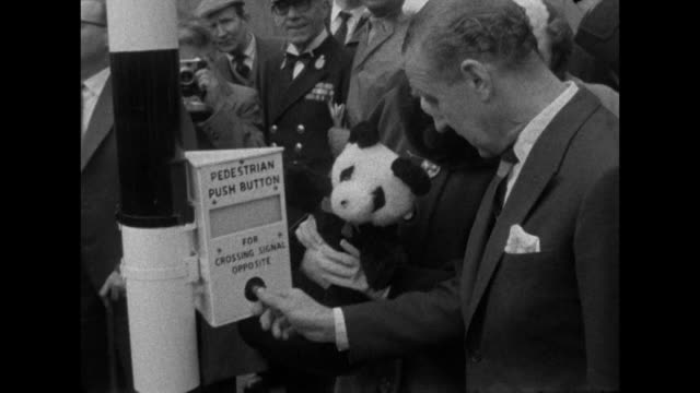 sequence showing transport minister ernest marples and the mayor of lambeth unveiling the new panda crossing near waterloo - bbc archive stock-videos und b-roll-filmmaterial