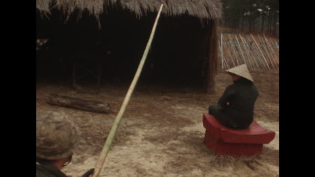 sequence showing troops training at a simulated vietnamese village at fort benning georgia - massenmord stock-videos und b-roll-filmmaterial