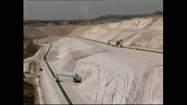 sequence showing two large bucket excavators working in an open quarry in germany; 2000. rotating bucket machine head. excavator turning slowly. two... - mining stock videos & royalty-free footage