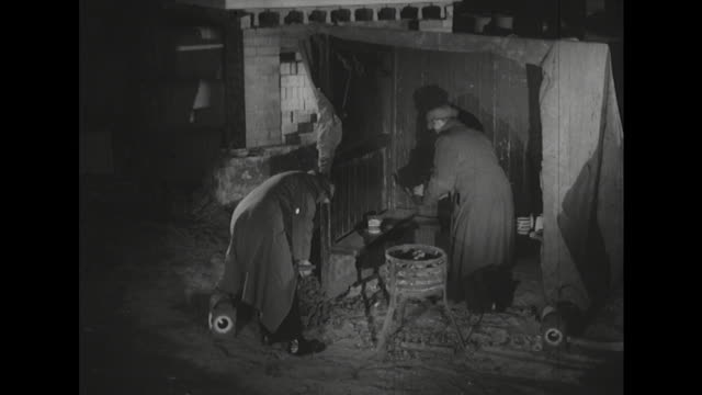 sequence showing two night watchmen making a pot of tea in a roadside shack - heißes getränk stock-videos und b-roll-filmmaterial