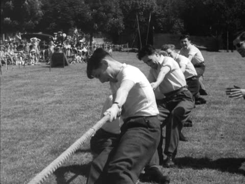 Sequence showing two teams taking part in a tugofwar contest during the Festival of Youth celebrations at Hampton Court