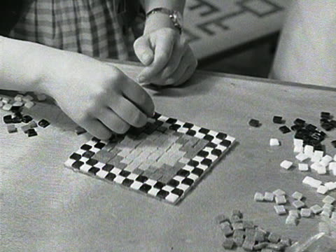 sequence showing two women assembling a mosaic picture at a handicrafts exhibition at earls court exhibition hall. - earls court stock videos & royalty-free footage