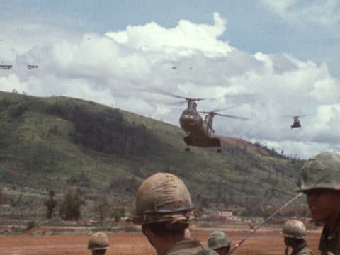sequence showing us soldiers boarding a transport helicopter in vietnam - vietnamkrieg stock-videos und b-roll-filmmaterial