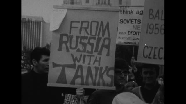 Sequence showing various placards at a demonstration in London against the Russian led invasion of Czechoslovakia