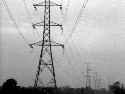 a sequence showing various types of electrical pylons - electricity pylon stock videos and b-roll footage