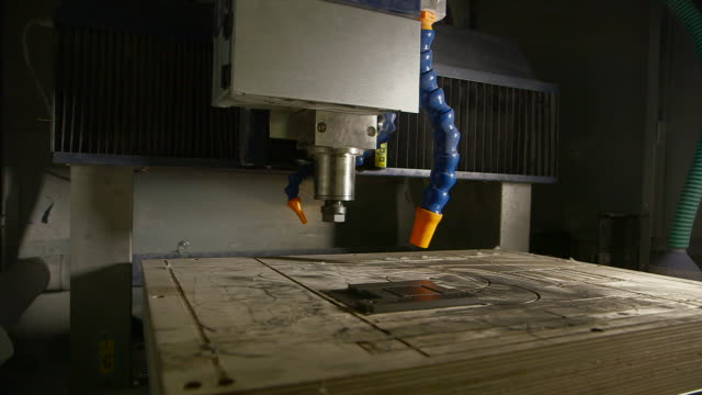 sequence showing views of a heavy-duty machine in a workshop with two nozzles, uk. - squirting stock videos and b-roll footage