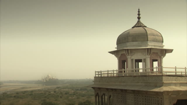 Sequence showing views of Agra Fort's Musamman Burj and its position in relation to the Taj Mahal, India.