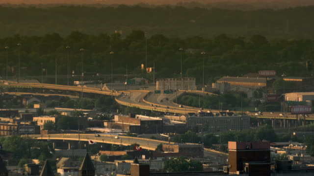 Sequence showing views of industrial buildings and roads in Birmingham, Alabama, at sunset, US.
