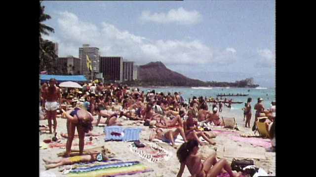 sequence showing waikiki beach in hawaii; 1983 - bikini stock-videos und b-roll-filmmaterial
