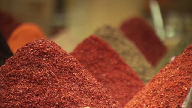 Sequence showing warmly-coloured spices being displayed at the Grand Bazaar in Istanbul, Turkey.