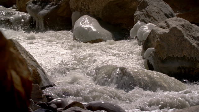 sequence showing water flowing over rocks along the ganges in uttarakhand, india. - mountain range stock videos & royalty-free footage