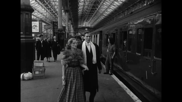 sequence showing well dressed people heading to the glyndebourne opera festival boarding a train at london's victoria station - glamour stock videos & royalty-free footage