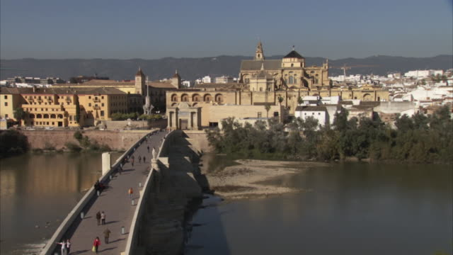 sequence showing wide shot and bell tower detail of the mosque-cathedral (mezquita) of cordoba, spain. - mesquita stock videos & royalty-free footage