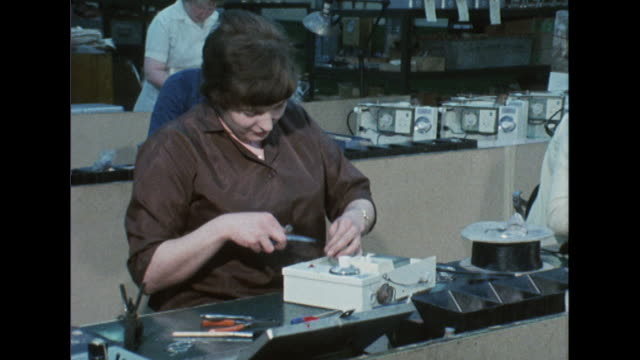 sequence showing women working in various factory environments - punch card stock videos & royalty-free footage