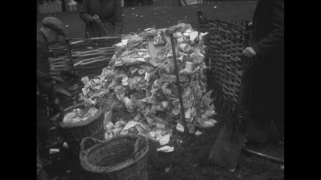 sequence showing workers cleaning up rubbish in hyde park following the queen's coronation celebrations - coronation stock videos and b-roll footage