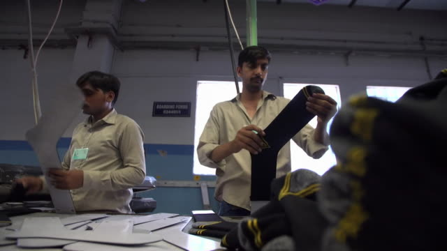 sequence showing workers labeling and packing socks at a factory in islamabad - traditional clothing stock videos & royalty-free footage