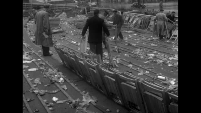 sequence showing workers removing chairs and rubbish from the mall following the queen's coronation celebrations - coronation stock videos and b-roll footage